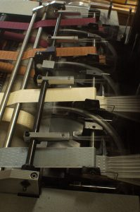 loom producing woven jacquard ribbons from fine silk thread