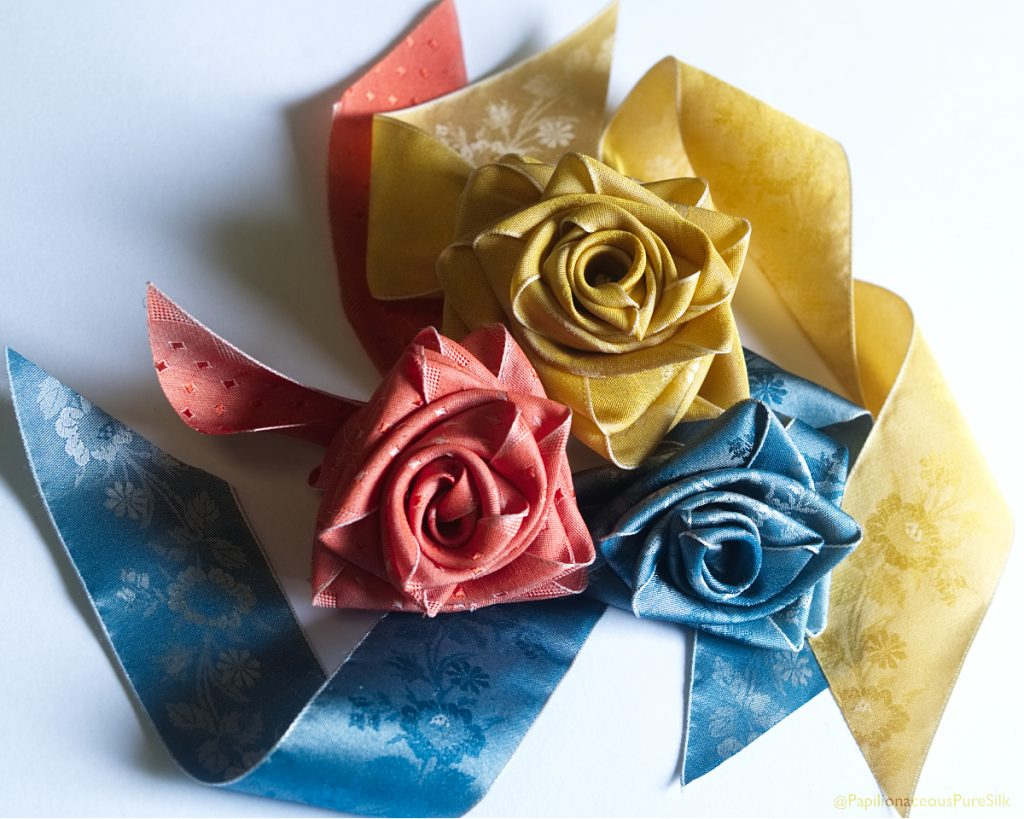 Silk ribbon flowers made from Papilionaceous floral silk.