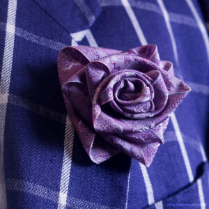Very Papilionaceous Petal Pin styled from our own rose pink jacquard silk ribbon mounted on a Sterling Silver stick pin. Silk Boutonniere on vintage Kenzo linen jacket.