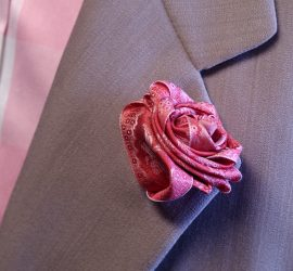 Very Papilionaceous Petal Pin styled from our own rose pink jacquard silk ribbon mounted on a Sterling Silver stick pin worn on a pure wool wedding suit by Nicole Farhi.