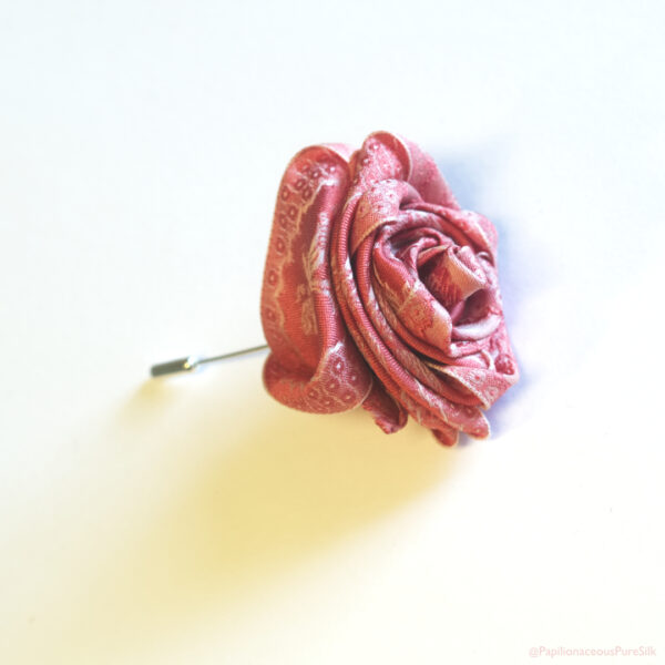 Papilionaceous Petal Pin styled from our own rose pink jacquard silk ribbon mounted on a Sterling Silver stick pin.