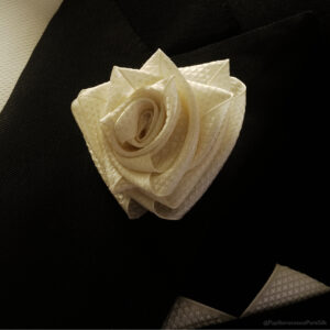 Very Papilionaceous Petal Pin styled from our own rose pink jacquard silk ribbon mounted on a Sterling Silver stick pin. Silk Boutonniere on vintage dinner suit.