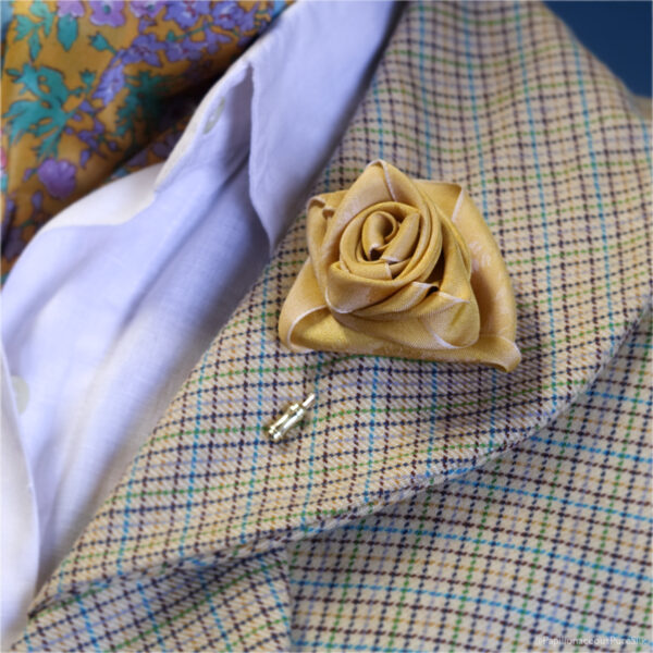 Silk Boutonnière Primrose Stick Pin made from Floral Papilionaceous Silk Ribbon. On woman's wool check jacket