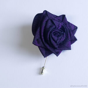 Papilionaceous Purple Rose Petal Pin styled from our own rose pink jacquard silk ribbon mounted on a Sterling Silver stick pin. Made from Papiluionaceous jacquard silk ribbon.
